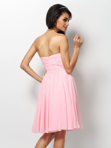 A-Line/Princess Sleeveless Pleats Knee-Length Strapless Chiffon Bridesmaid Dresses