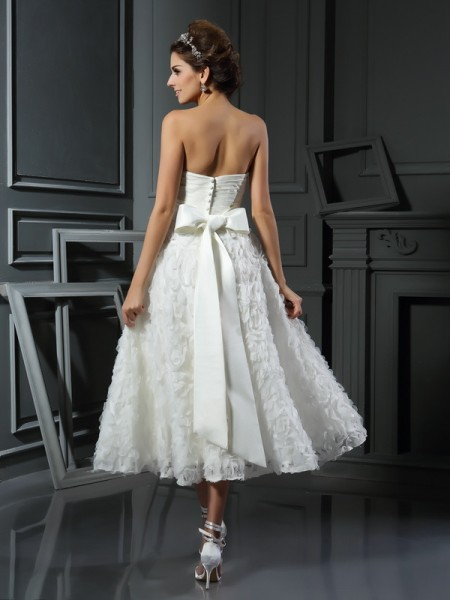 A-Line/Princess Sleeveless Tea-Length Bowknot Satin Sweetheart Wedding Dresses